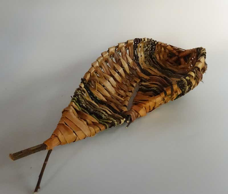 "Asymmetrical Fish Basket; Cedar bark and willow; 12""x 6"""